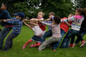 Local children tug of war during a community park festival